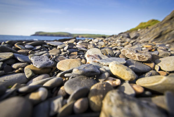 Rocks on the sea front, showing diverse investment decisions in financial planning