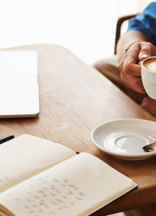 Financial adviser in Newark going over his diary for the day with a coffee