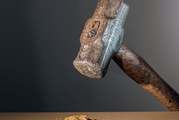Image of hammer htting a nut, illustrating how financial planning can go wrong with independent financial advice from an adviser in Lincoln