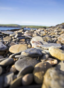 Stones on the beach, illustrating choice and variety in investment choices when discussing plans with a financial adviser in Nottingham