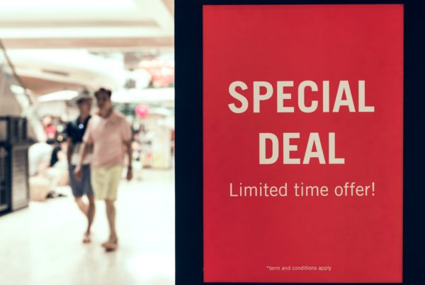 "Two Newark IFAs walk past a ""Special Deal"" sign"